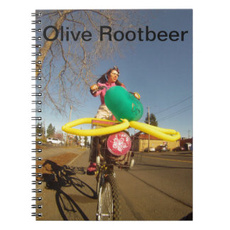 Olive Rootbeer on her tall bike. Notebook