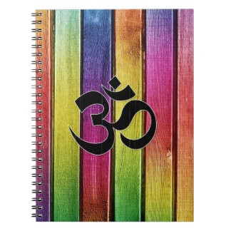 Om sign on multicolor wood notebooks
