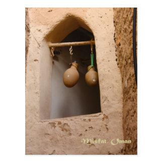 Oman - Water Bottles in the Window Postcard