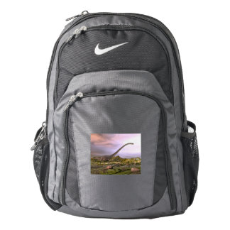 Omeisaurus walking in the desert by sunset backpack
