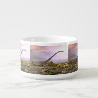 Omeisaurus walking in the desert by sunset bowl