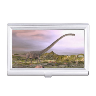 Omeisaurus walking in the desert by sunset business card holder