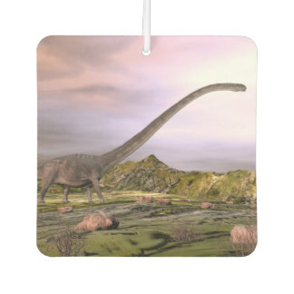 Omeisaurus walking in the desert by sunset car air freshener