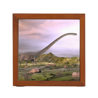 Omeisaurus walking in the desert by sunset desk organizer