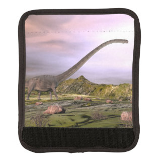 Omeisaurus walking in the desert by sunset luggage handle wrap