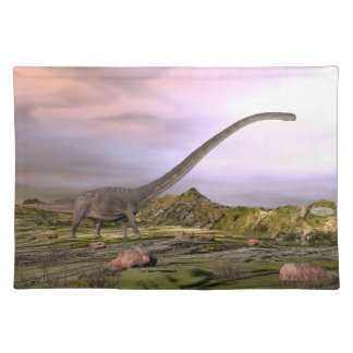 Omeisaurus walking in the desert by sunset placemat