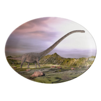 Omeisaurus walking in the desert by sunset porcelain serving platter