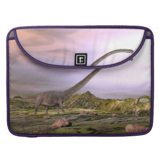 Omeisaurus walking in the desert by sunset sleeve for MacBook pro