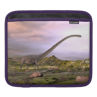 Omeisaurus walking in the desert by sunset sleeves for iPads