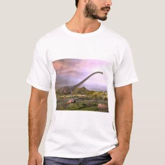 Omeisaurus walking in the desert by sunset T-Shirt