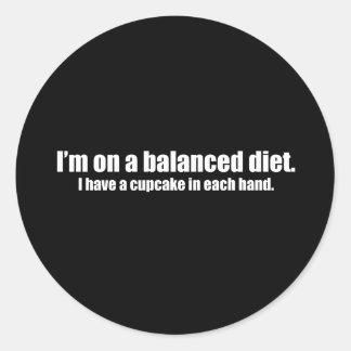 On a Balanced Diet Cupcake in Each Hand Round Sticker