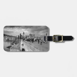 on the Charles Bridge under a stormy sky in Prague Bag Tag