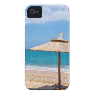 One beach umbrella and sunloungers near ocean iPhone 4 Case-Mate case