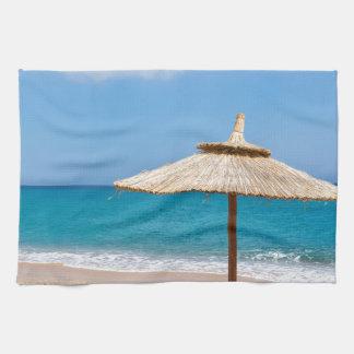 One beach umbrella and sunloungers near ocean kitchen towel