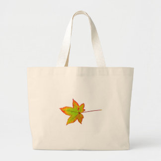 One colorful maple leaf in autumn on white large tote bag