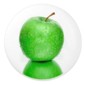 ONE GREEN APPLE ON CERAMIC KNOB. CERAMIC KNOB