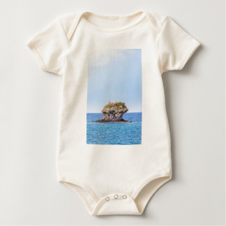 One outstanding rock rising from sea level baby bodysuit