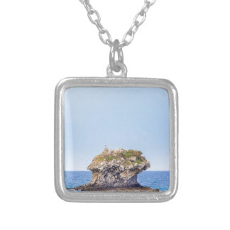 One outstanding rock rising from sea level silver plated necklace