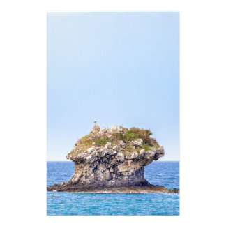 One outstanding rock rising from sea level stationery
