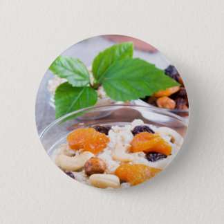 One portion of oatmeal with fruit and berries 2 inch round button