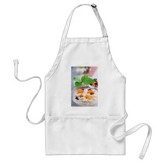 One portion of oatmeal with fruit and berries standard apron