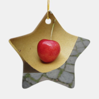 One red cherry on straw food paper ceramic ornament