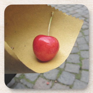 One red cherry on straw food paper coaster