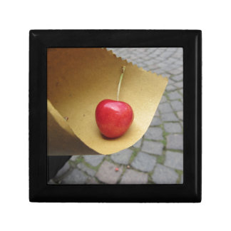 One red cherry on straw food paper gift box