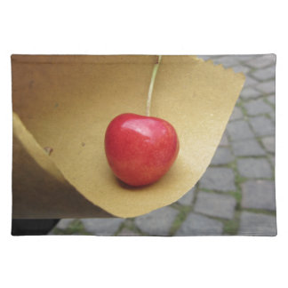 One red cherry on straw food paper placemat