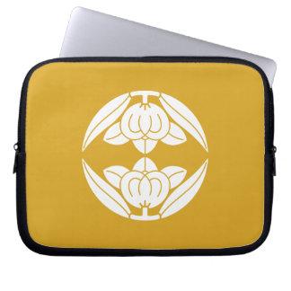 Opposite it is, the orange laptop sleeve