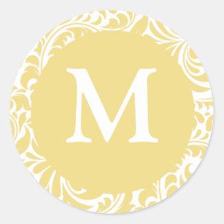 Or antique du monogramme M et faveurs blanches de Autocollant Rond