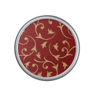 Or baroque de conception sur le rouge haut-parleur bluetooth