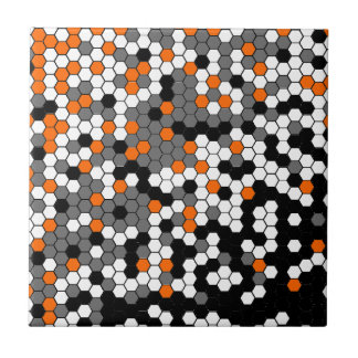 Orange and black honeycomb design tile
