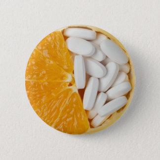 Orange and pills 2 inch round button