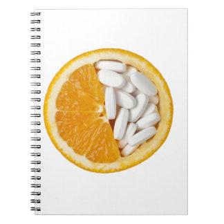 Orange and pills spiral notebook
