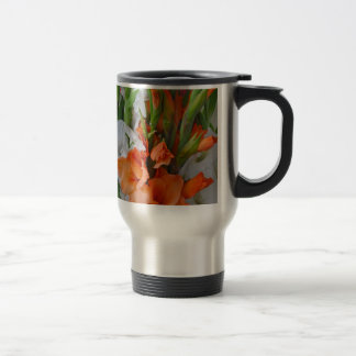 Orange and white gladiola flowers travel mug