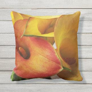 Orange and yellow calla lilies throw pillow