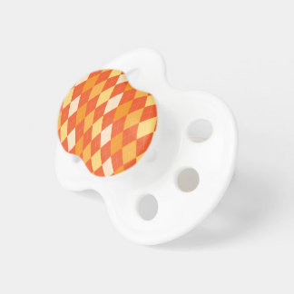 Orange argyle pattern pacifiers