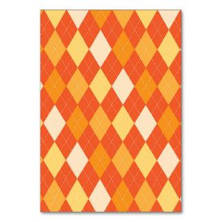 Orange argyle pattern table card