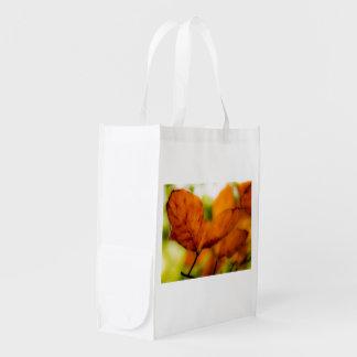 Orange autumn leaves reusable grocery bag