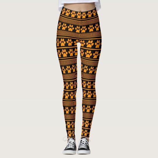 Orange black paw print pattern leggings