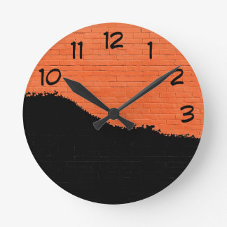 Orange Brick Wall with Black Peeling Paint Round Clock