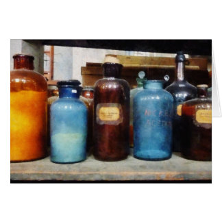 Orange, Brown and Blue Bottles of Chemicals Card