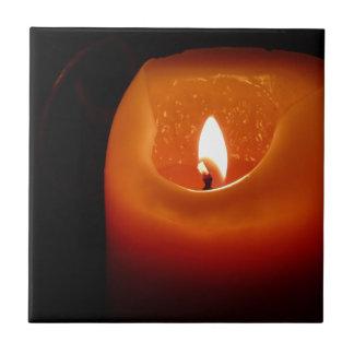 Orange candle ceramic tile