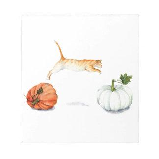 Orange Cat Jumping Between Pumpkins Notepad