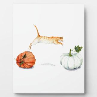 Orange Cat Jumping Between Pumpkins Plaque