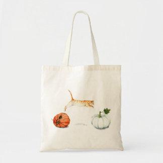 Orange Cat Jumping Between Pumpkins Tote Bag