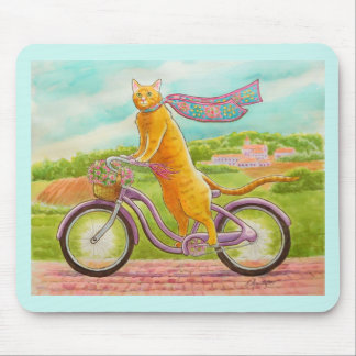 Orange Cat on a Purple Bicycle Mouse Pad
