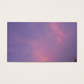 Orange clouds on the blue sky at sunrise business card