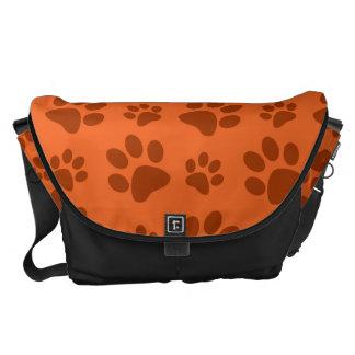 Orange dog paw print pattern commuter bags